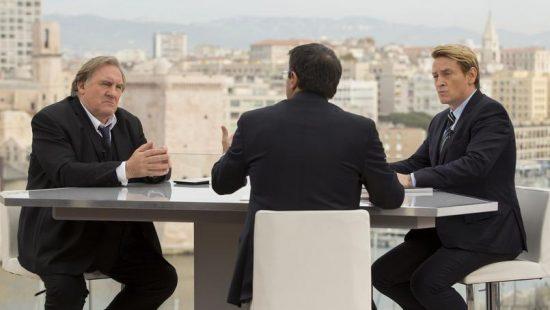 Il confronto televisivo tra Robert Taro (Depardieu) e Lucas Barres (Magimel)